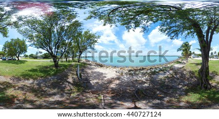 A shady place to sit and relax by the bay 360 spherical image - stock photo