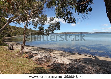 A shallow bay and beach of Oyster shells on the Tasmanian coast just outside the settlement of Kettering
