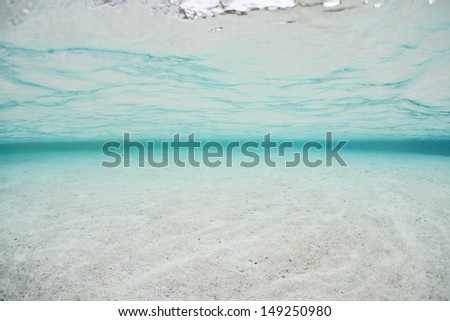 A shallow sand flat is flooded by clear, tropical water in the Solomon Islands.  This area is found within the Coral Triangle and is high biological diversity. - stock photo
