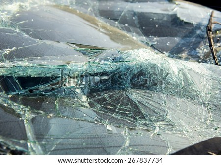 A shattered windshield from a crashed car. - stock photo