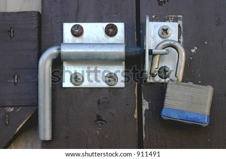 A shed door with a unlocked padlock. - stock photo
