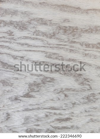 A sheet of grey wood wavy patterned background. - stock photo
