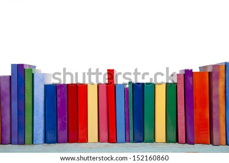 A shelf of colorful books and novels against a white background. - stock photo