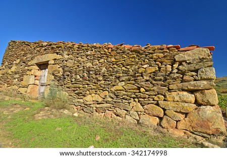 A shepherd's hut in northern Portugal made from dry stone granite stones with no windows - stock photo