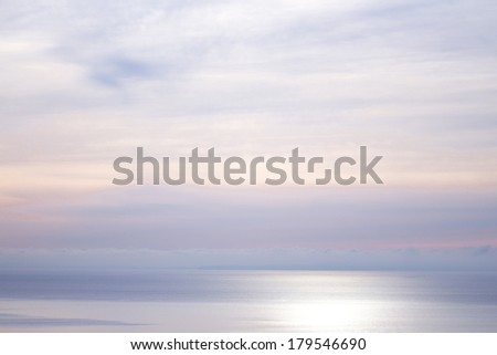 a shimmering sunset background on a foggy day  - stock photo