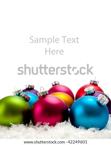 A shiny blue Christmas ornament/bauble on snow with copy space - stock photo