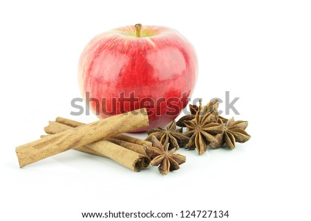 A shiny fresh red Elstar apple (Malus domestica) with cinnamon and star anise, on a white background. - stock photo