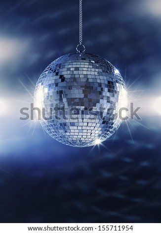 A Shiny mirror ball hanging from the ceiling. - stock photo