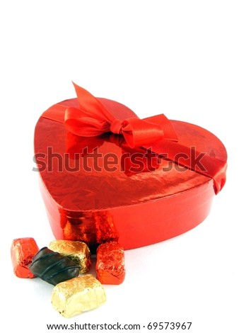 A shiny red love heart gift box with red ribbon & chocolates