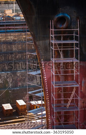 A ship in a dry dock. - stock photo
