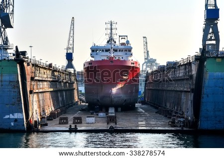 a ship in a floating dry dock - stock photo