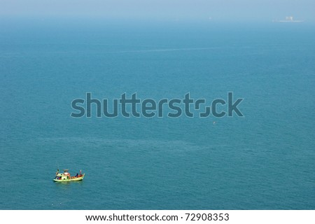a ship in foggy day sea - stock photo