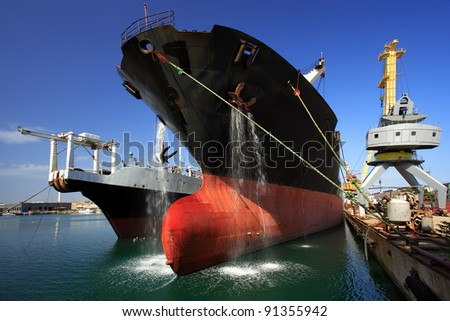 A ship in port - stock photo