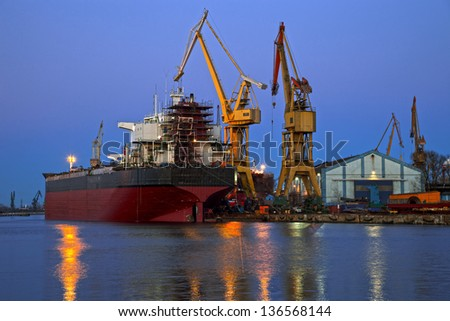 A ship is repaired in shipyard. - stock photo