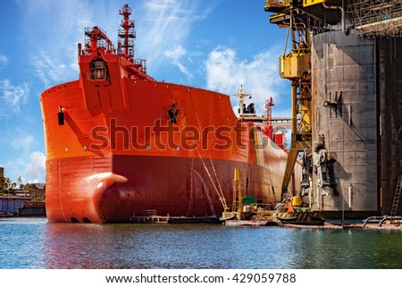 A ship under repair at shipyard in Gdansk, Poland. - stock photo