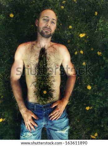 a shirtless man surrounded by weeds vintage toned - stock photo