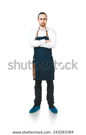 A shoot of young caucasian men in apron as a barmen. Crossing hands on the chest.  Isolated against white background.