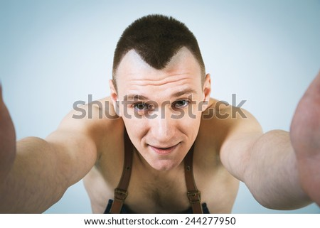 A shoot of young caucasian naked men in apron as a barmen. Doing selfie.Wide Angle. - stock photo