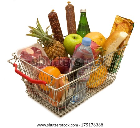 A shopping basket full of fresh colorful vegetables isolated on white background  - stock photo