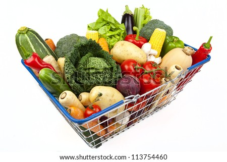 A shopping basket full of Vegetables on a white background.