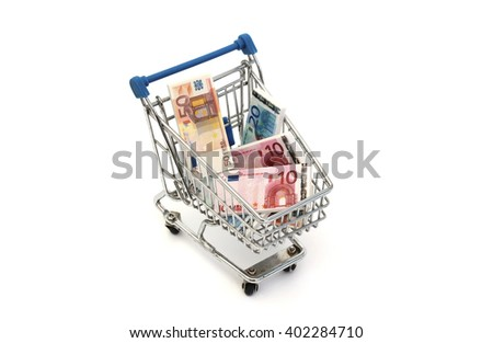 A shopping cart filled with euro bills - stock photo