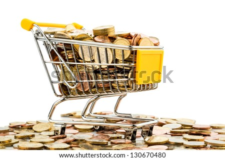 a shopping cart is filled with well-euro coins, symbolic photo for purchasing power and consumption - stock photo