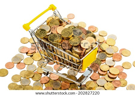 a shopping cart is well stocked with euro coins, symbolic photo for purchasing power and consumption - stock photo