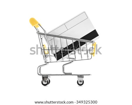 a shopping cart with credit card on white - stock photo