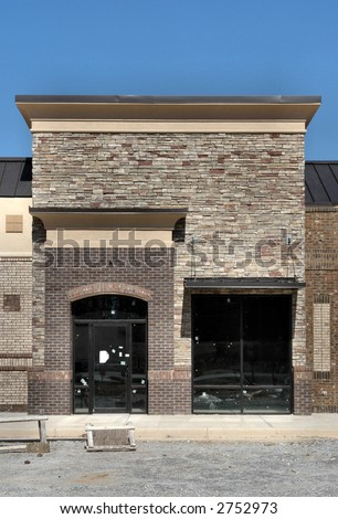 A shopping center storefront under construction, made to appear like a small town street.