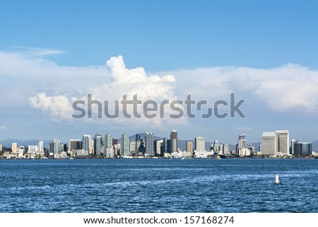 A shoreline, panoramic view of downtown San Diego, California shot from the harbor. - stock photo