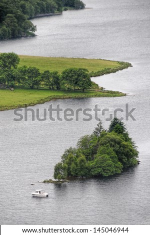 A short drive from Pitlochry, along a winding tree-lined road, hugging the River Tummel, lies the Queen�s View. This famous vantage point looks out over one of the most iconic panoramas in Scotland - stock photo