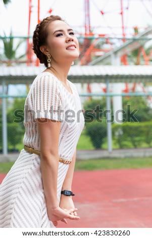 A shot of a beautiful asian woman outdoor - stock photo