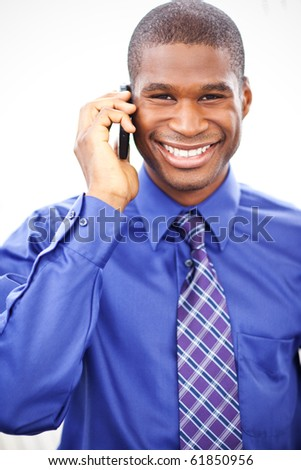 A shot of a black businessman on the phone - stock photo