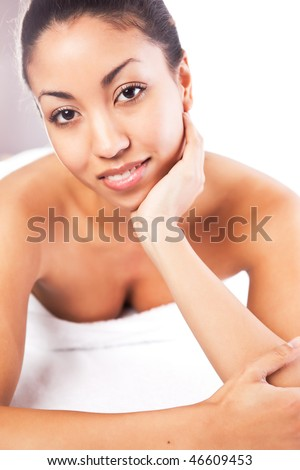 A shot of a black woman lying down at a spa