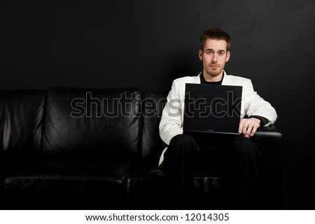 A shot of a caucasian businessman working on his laptop