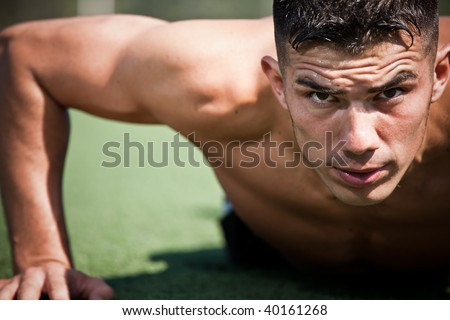 A shot of a hispanic athlete doing a push-up