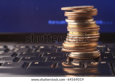 A shot of a laptop and coins