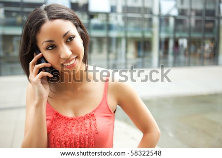 A shot of a mixed race woman talking on the phone