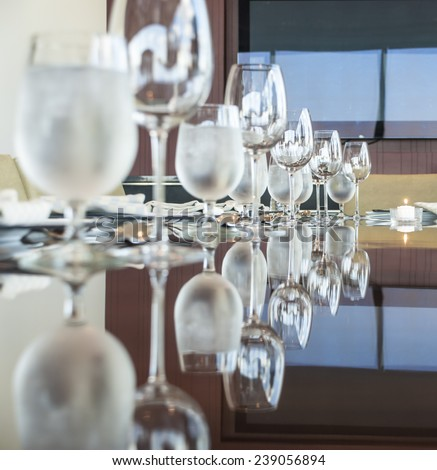 a shot of a restaurant with glass on table - stock photo