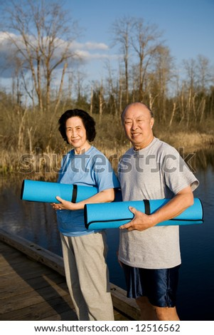 A shot of a senior asian couple getting ready for exercise