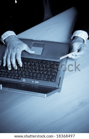 A shot of a senior businessman shopping online