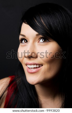 A shot of a smiling beautiful young woman - stock photo