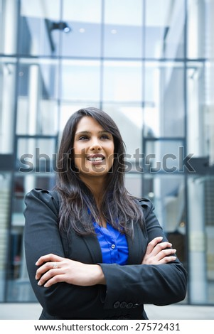 A shot of a smiling indian businesswoman outdoor - stock photo