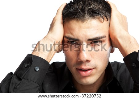 A shot of a stressed hispanic businessman - stock photo