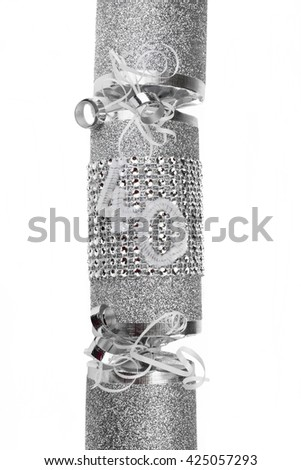 A shot of a 40th Birthday or Anniversary Cracker also known as a Bon Bon.  A cracker consists of a cardboard tube wrapped in a brightly decorated twist of paper with a gift in the central chamber.