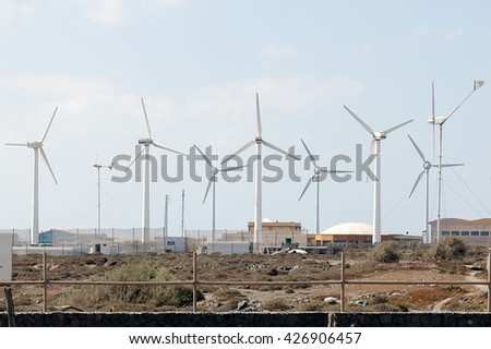 A shot of a wind farm with many turbines