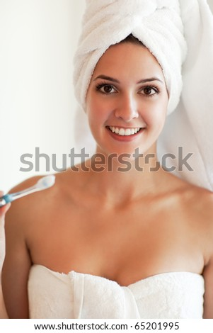 A shot of a young beautiful woman holding a tooth brush