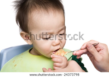 A shot of an asian baby during feeding time