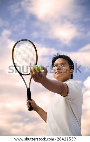 A shot of an asian tennis player - stock photo