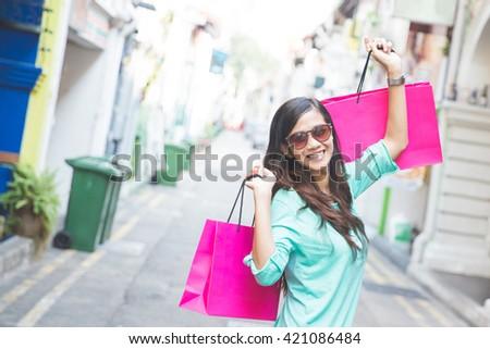 A shot of an asian woman shopping outdoor - stock photo